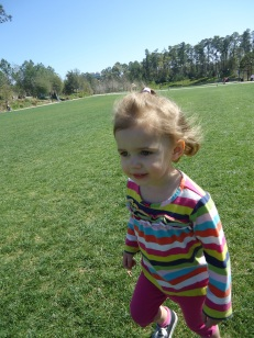 My own wild girl, running, after we read in the park and took a boat ride, but before we had our picnic in the grass.